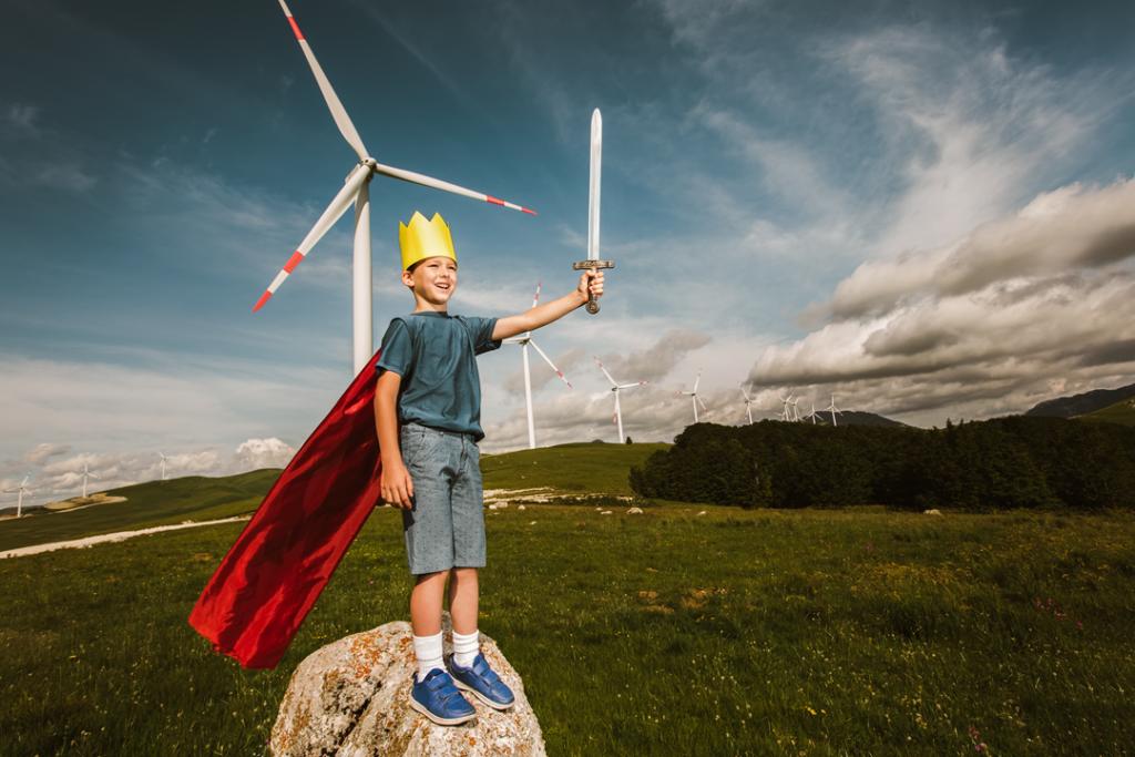 Kid fighting windmills